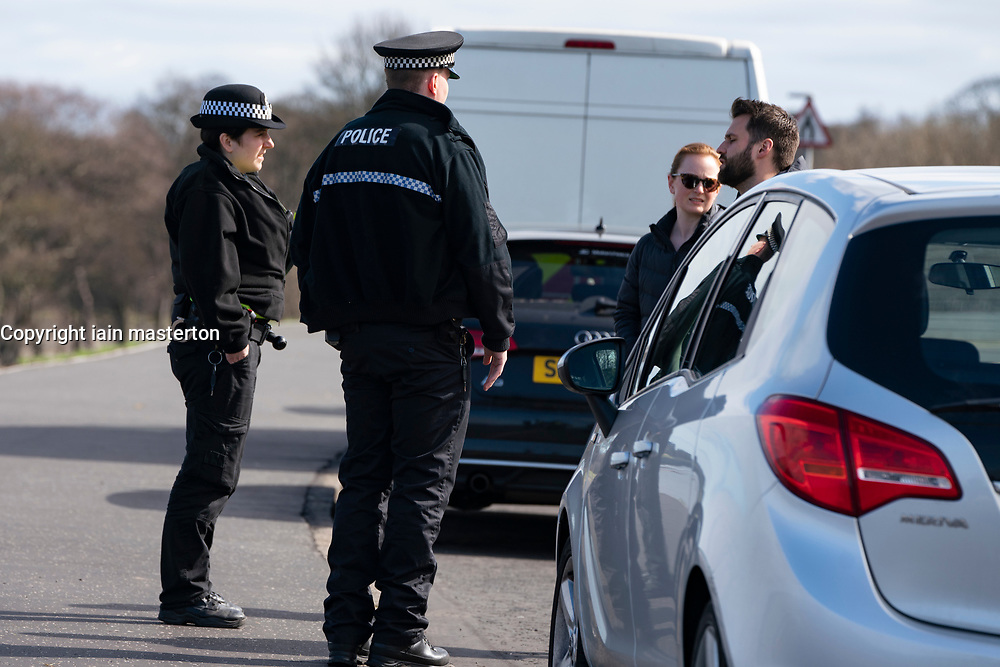 Edinburgh, Scotland, UK. 31 March, 2020. Police patrol public parks and walking areas to enforce the coronavirus lockdown regulations about being outdoor. Police patrol Marine Drive and speak to couple who have driven there.  Iain Masterton/Alamy Live News