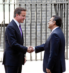 © Licensed to London News Pictures. LONDON, UK  01/07/11. The President of Pakistan, Asif Ali Zardari, is met by the British Prime Minister, David Cameron, on Downing Street in London today (Friday). Talks between Mr Cameron and Mr Zadari are expected to discuss allied troop withdrawals from Afghanistan and security on the Afghanistan/Pakistan border.  Please see special instructions for usage rates. Photo credit should read Matt Cetti-Roberts/LNP