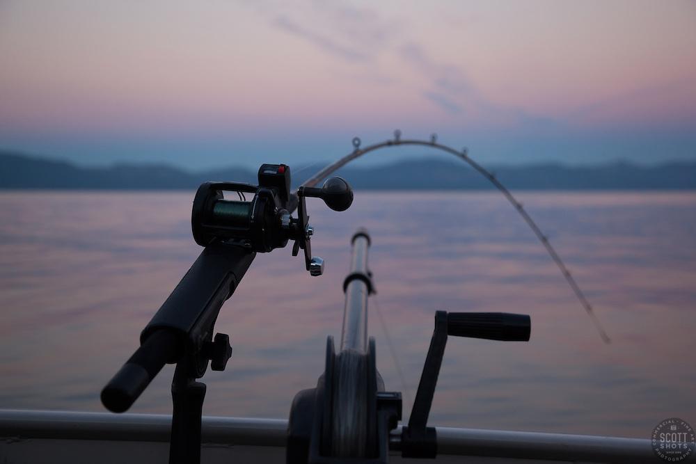 """Sunrise Fishing on Lake Tahoe 7"" - Photograph of a fishing pole and down rigger fishing on Lake Tahoe at sunrise."