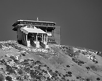 Upper Gondola station at the top of Mount Komagatake from the deck of a tourist pirate ship on Lake Ashi. Image taken with a Nikon 1 V3 camera and 70-300 mm VR telephoto zoom lens.