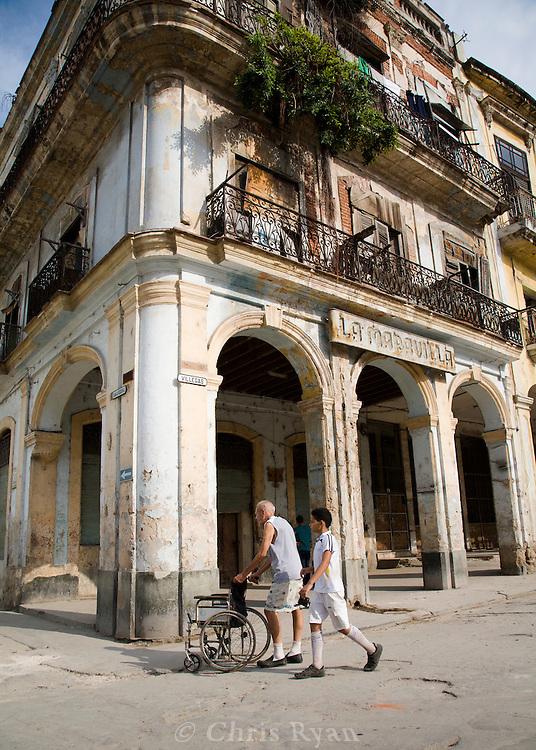 Elderly man and child walking in Havana, Cuba