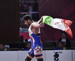 JAKARTA, Aug. 19, 2018  Hassan Yazdanicharati of Iran celebrates after Men's Wrestling Freestyle 86 kg Final against Domenic Michael Abounader of Lebanon at the 18th Asian Games at Jakarta, Indonesia, Aug. 19, 2018. (Credit Image: © Li He/Xinhua via ZUMA Wire)