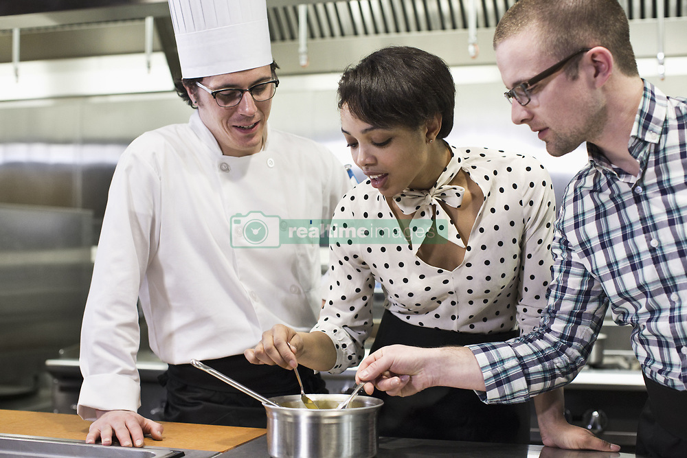 March 29, 2013 - A caucaisan male chef teaching a cooking class for a mixed race grop of students in a commercial kitchen, (Credit Image: © Mint Images via ZUMA Wire)