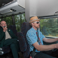While riding on a tour bus, Banff National Park naturalist Duncan Bayne describes natural features to members of a photography seminar.