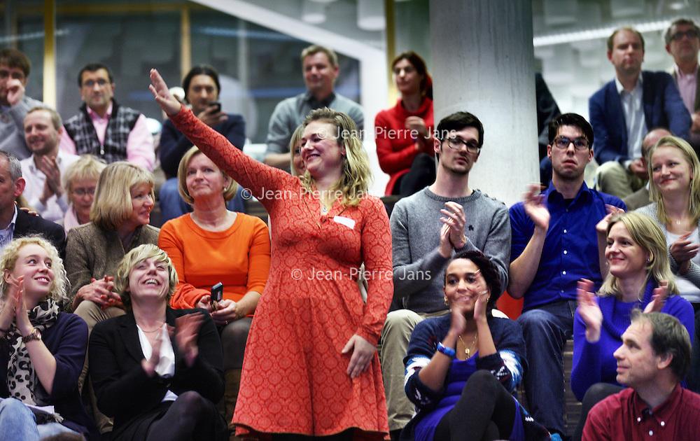 Nederland, Amsterdam , 29 november 2013.<br /> ALV PvdA Amsterdam in Sint Nicolaaslyceum aan de Beethovenstraat in Amsterdam.<br /> Op de foto: Carolien de Heer is blij met haar positie op de kandidatenlijst.<br /> Foto:Jean-Pierre Jans