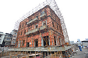 WUHAN, CHINA - MARCH 09: (CHINA OUT)<br /> <br />  Workers work to prepare for the monolithic movement of one historical and cultural site in Changdi Street on March 9, 2016 in Wuhan, Hubei Province of China. The historical and cultural site is cultural relics protection units used as a volunteer fire headquarter in early Republic of China. It\'s said that the ancient architecture will move monolithically to east 90 meters and will spend three or four months. It\'s the first time that building gets moved entirely in Wuhan City.<br /> ©Exclusivepix Media