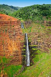 "Waipo`o or Waipoo Falls (approx. 800 foot drop), Waimea Canyon, the ""Grand Canyon of the Pacific"", approximately one mile wide and ten miles long, more than 3,500 feet deep, State Park, Kauai, Hawaii"