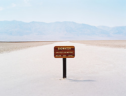 Sign in the middle of the dry salt bed in Badwater Basiin, Death Valley