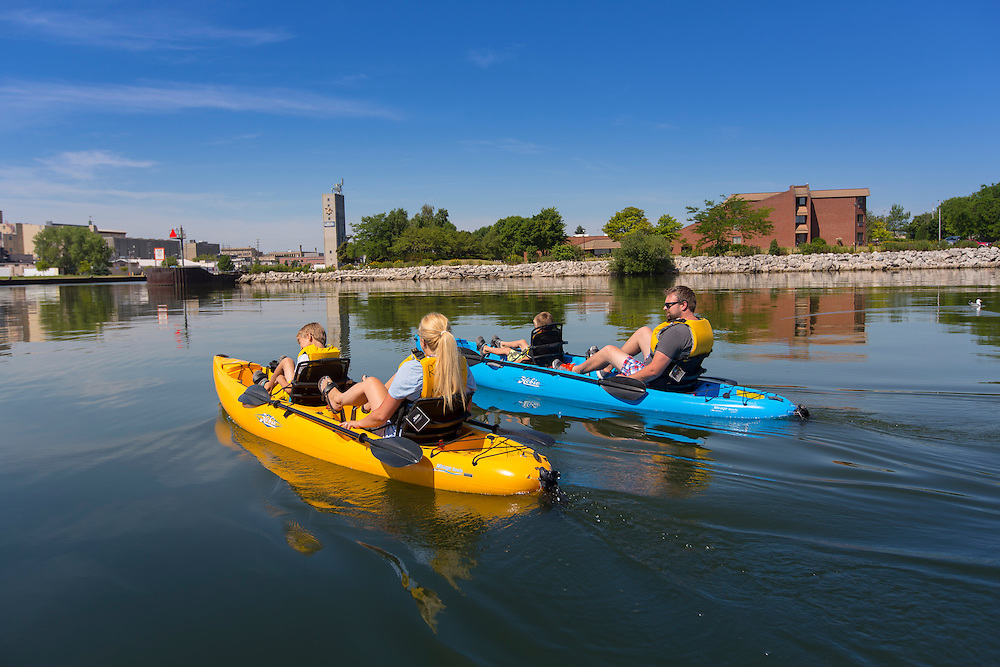 The Ludtke family peddle kayaks in Manitowoc, Wisconsin.  Photo by Mike Roemer