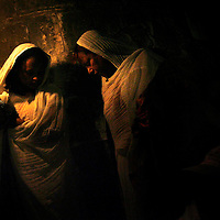 Ethiopian Orthodox Christian clergymen hold candles outside Deir Al-Sultan in the Church of the Holy Sepulchre, traditionally believed to be the site of the crucifixion of Jesus Christ, during the ceremony of the Holy Fire in Jerusalem's Old City, Saturday, April 26 2008.  *** Local Caption *** ??????........?????........?????........?? ?????........????? ????........????........??? ?? ?????........??........??........?????