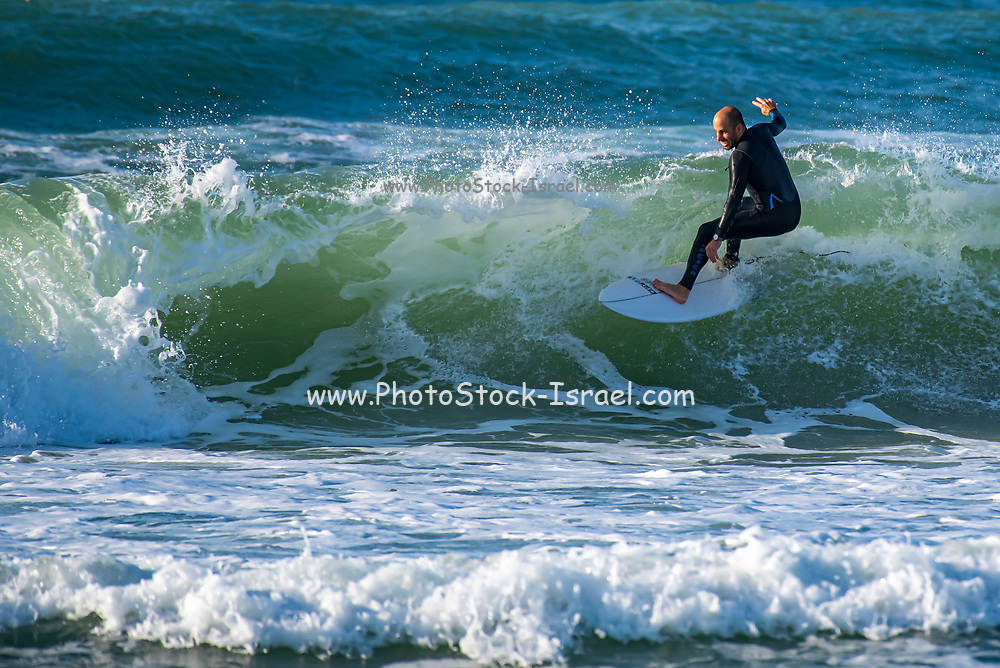 Surfer is surfing in the Mediterranean Sea, Israel