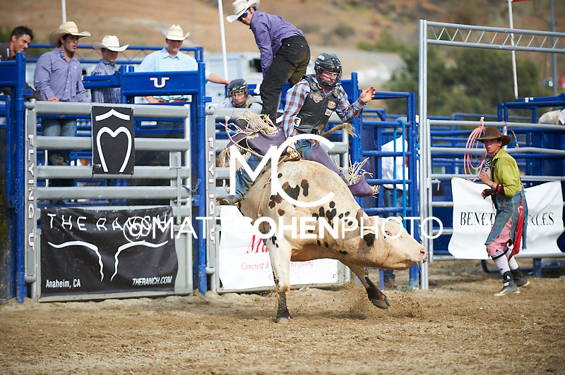 Bull rider Brennon Eldred of Sulphur, OK rides X9 at the Rancho Mission Viejo Rodeo in San Juan Capistrano, CA.  <br /> <br /> <br /> UNEDITED LOW-RES PREVIEW<br /> <br /> <br /> File shown may be an unedited low resolution version used as a proof only. All prints are 100% guaranteed for quality. Sizes 8x10+ come with a version for personal social media. I am currently not selling downloads for commercial/brand use.