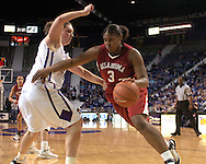 Oklahoma center Courtney Paris (R) drives to the basket agaisnt Kansas State center Jessica McFarland (L), during the first half at Bramlage Coliseum in Manhattan, Kansas, February 21, 2006.  The 9th ranked Sooners defeated K-State 78-64.