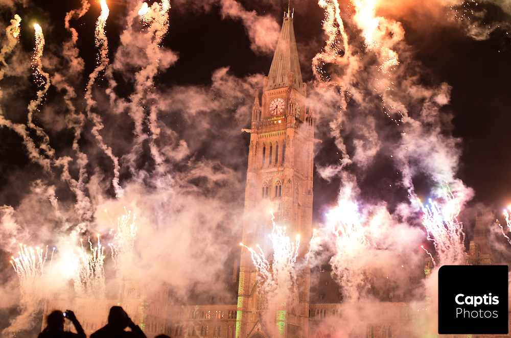 Fireworks explode around the Peace Tower during the opening ceremony for the holiday lights on Parliament Hill. December 3, 2014.