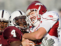 STARKVILLE, MS - NOVEMBER 22:   Nathan Dick #10 of the Arkansas Razorbacks is tackled by Charles Mitchell #4 of the Mississippi State Bulldogs at Davis Wade Stadium on November 22, 2008 in Starkville, Mississippi.  The Bulldogs defeated the Razorbacks 31 to 28.  (Photo by Wesley Hitt/Getty Images) *** Local Caption *** Nathan Dick; Charles MitchellUniversity of Arkansas Razorback Men's and Women's athletes action photos during the 2008-2009 season in Fayetteville, Arkansas....©Wesley Hitt.All Rights Reserved.501-258-0920.