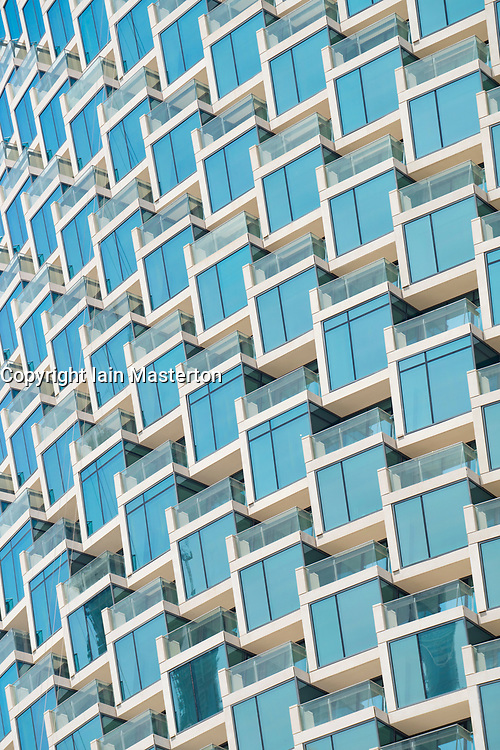 Detail of windows and balconies of new high rise apartment building in Downtown Dubai, UAE, United Arab Emirates.