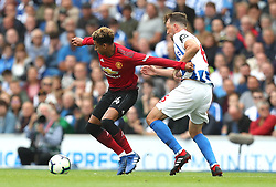 Manchester United's Jesse Lingard (left) and Brighton & Hove Albion's Dale Stephens (right) battle for the ball during the Premier League match at the AMEX Stadium, Brighton.