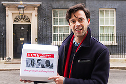 "Downing Street, London, January 7th 2015. TV star 2015-01-07 TV star Jolyon Rubinstein delivers a ""Make Lying in Parliament History"" petition with 111,913 signatures to 10 Downing Street. The petition aims ""to start a debate about the importance of the truth in politics"" and comes off the back of his satirical TV show The Revolution Will be Televised which has been "" highlighting the corruption, greed and hypocrisy in our system"" and wants to make lying in Parliament a criminal offence. PICTURED: Jolyon Rubinstein outside 10 Downing Street"