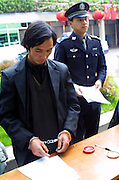 Man Digs Grave And Sells Bones For Ghost Marriage<br /> <br /> The image shows Yang Jinyu, a peasant from Xinghuo Village who stolen six skeletons of adult female to sell for ghost marriage is caught by police on March 28, 2005 in Xi'an, Shaanxi Province of China. Yang Jinyu, a peasant from Xinghuo Village in Shaanxi digged several graves and collected six skeletons of adult female from his village after hearing that a skeleton could be sold for up to 300 to 500 RMB (about 48 to 80 USD) for ghost marriage when he worked in Shanxi. But on Yang's way to Shanxi, he was suspected and caught by policeman at Xi'an Railway Station on March 28, 2005.<br /> ©Exclusivepix Media