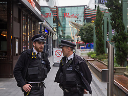 © Licensed to London News Pictures.  17/10/2021. London, UK. Police guard entrance outside Westfield Shopping Centre while Firefighters work inside the shop in Stratford, east London as staff and shoppers had been evacuated due to a fire alarm caused by a smoke.  Photo credit: Marcin Nowak/LNP