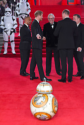 The Duke of Cambridge and Prince Harry with BB-8 at the european premiere of Star Wars: The Last Jedi held at The Royal Albert Hall, London. Photo credit should read: Doug Peters/EMPICS Entertainment