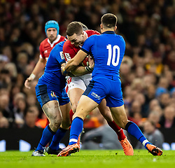 George North of Wales under pressure from Tommaso Allan of Italy<br /> <br /> Photographer Simon King/Replay Images<br /> <br /> Six Nations Round 1 - Wales v Italy - Saturday 1st February 2020 - Principality Stadium - Cardiff<br /> <br /> World Copyright © Replay Images . All rights reserved. info@replayimages.co.uk - http://replayimages.co.uk