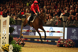 Peter Scudamore competes in the Markel Champions Challenge in aid of the Injured Jockeys Fundduring day four of the London International Horse Show at London Olympia. PRESS ASSOCIATION Photo. Picture date: Friday December 15, 2017. See PA story EQUESTRIAN Olympia. Photo credit should read: Steve Parsons/PA Wire