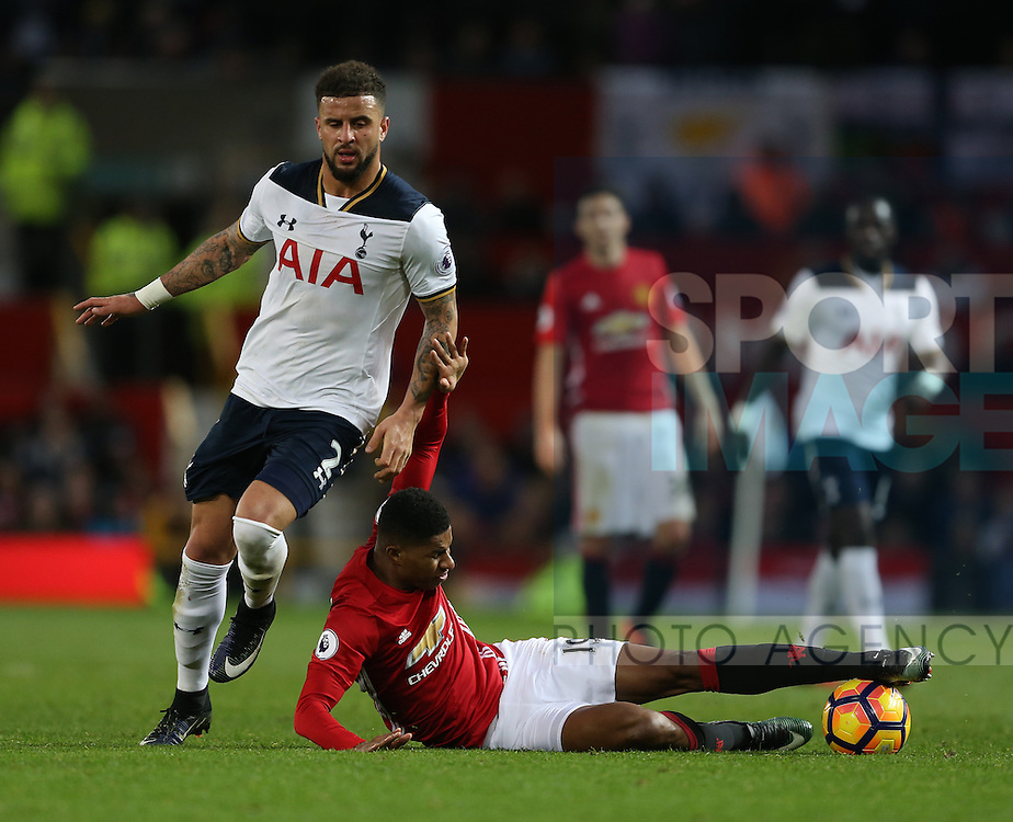Kyle Walker of Tottenham drags down Marcus Rashford of Manchester United during the English Premier League match at Old Trafford Stadium, Manchester. Picture date: December 11th, 2016. Pic Simon Bellis/Sportimage