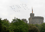 © Licensed to London News Pictures. 19/05/2012. WIndsor, UK. 27 Hawks fly over Windsor Castle in the formation of ER to celebrate the Jubilee year. Armed Forces muster and parade in Windsor today , 19th May 2012, in tribute to Her Majesty the Queen for the Diamond Jubilee. 2,500 troops paraded through the town before the Queen and Duke of Edinburgh to mark the Diamond Jubilee. Once the parade has passed the Queen and Duke traveled along the same route to an arena within Home Park, where the troops mustered. A tri-service flypast of 78 aircraft, including helicopters, Hawks, the Battle of Britain Memorial Flight, the Red Arrows and Tornados went overhead. Photo credit : Stephen Simpson/LNP