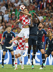 MOSCOW, July 15, 2018  Blaise Matuidi (R top) of France competes for a header with Dejan Lovren (L top) of Croatia during the 2018 FIFA World Cup final match between France and Croatia in Moscow, Russia, July 15, 2018. (Credit Image: © Yang Lei/Xinhua via ZUMA Wire)