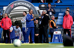 Chelsea manager Maurizio Sarri (third left) and Manchester United manager Jose Mourinho have a conversation prior to the beginning of the match