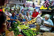 Romans buying their food at a local market, Rome, Italy.