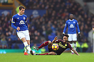 Ross Barkley of Everton passes the ball back as Raheem Sterling of Manchester City slips as he tries to stop him. Premier league match, Everton v Manchester City at Goodison Park in Liverpool, Merseyside on Sunday 15th January 2017.<br /> pic by Chris Stading, Andrew Orchard sports photography.
