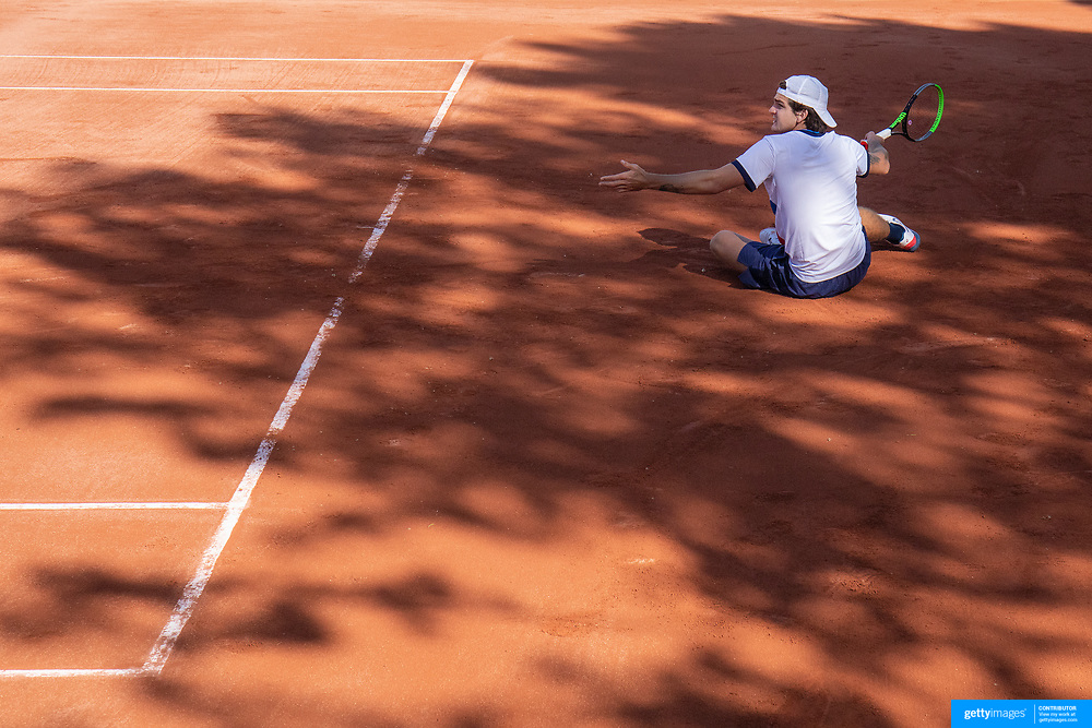 PARIS, FRANCE May 24.  Thiago Seyboth Wild of Brazil slips and falls during his loss against Viktor Troicki of Serbia on the first day of the qualifying tournament at the 2021 French Open Tennis Tournament at Roland Garros on May 24th 2021 in Paris, France. (Photo by Tim Clayton/Corbis via Getty Images)