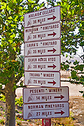 Wine tour sign with distances to wineries, Harmony, California