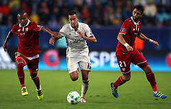 Real Madrid's Lucas Vazquez (centre) and Sevilla's Mariano (left) and Nicolas Pareja (right)