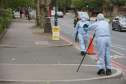 ©Licensed to London News Pictures 26/09/2020  <br /> Norbury, UK. Police forensics on scene. Police have cordoned off an area in front of Andersons Heights in Norbury, South London where the gunman who shot Sgt Ratana was arrested for having ammunition. A murder investigation has been launched by police after the death of custody police sergeant Matt Ratana at the Croydon Custody Centre in South London yesterday.Photo credit:Grant Falvey/LNP