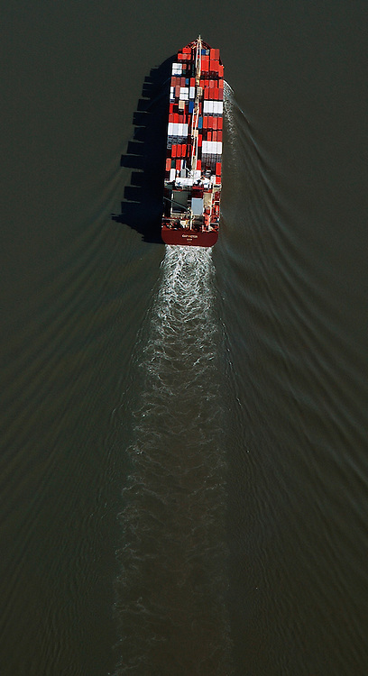 Aerial view of a container cargo ship on the Delaware River outside Wilmington Delaware