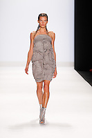 A model walks the runway at the filming of the Project Runway Spring 2015 Fashion Show during Mecedes-Benz Fashion Week in New York on September 5th, 2014