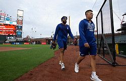 Oct 7, 2021; San Francisco, CA, USA; Los Angeles Dodgers pitchers Kenley Jansen, left and Julio Urías walk off the field during NLDS workouts. Mandatory Credit: D. Ross Cameron-USA TODAY Sports