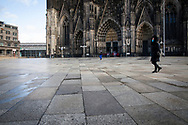 Corona Lockdown, December 17th. 2020. The almost deserted square around Cologne Cathedral, usually visited by thousands of people, Cologne, Germany.<br /> <br /> Corona Lockdown, 17. Dezember 2020. Die fast menschenleere Domplatte, normalerweise von tausenden Menschen besucht, Koeln, Deutschland.