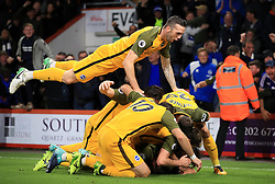 Brighton & Hove Albion's Solly March (obscured) celebrates scoring his side's first goal of the game with team-mates during the Premier League match at the Vitality Stadium, Bournemouth.