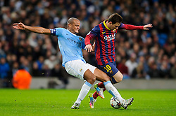 Barcelona Midfielder Lionel Messi (ARG) is challenged by Man City Defender Vincent Kompany (BEL) - Photo mandatory by-line: Rogan Thomson/JMP - Tel: 07966 386802 - 18/02/2014 - SPORT - FOOTBALL - Etihad Stadium, Manchester - Manchester City v Barcelona - UEFA Champions League, Round of 16, First leg.