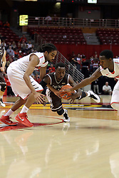 29 December 2014:  Tony Wills, Thomas Jackson, Daishon Knight during an NCAA non-conference interdivisional exhibition game between the Quincy University Hawks and the Illinois State University Redbirds at Redbird Arena in Normal Illinois.
