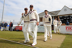 Somerset's Alex Barrow and Somerset's Lewis Gregory hug prior to entering the pitch.  - Photo mandatory by-line: Harry Trump/JMP - Mobile: 07966 386802 - 23/03/15 - SPORT - CRICKET - Pre Season Fixture - Day 1 - Somerset v Glamorgan - Taunton Vale Cricket Club, Somerset, England.