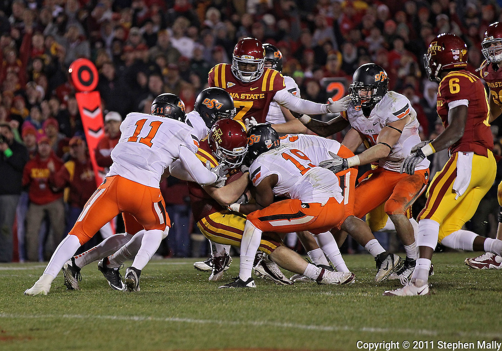 November 18, 2011: Iowa State Cyclones running back Jeff Woody (32) pushes for extra yards on a run during the second overtime of the NCAA football game between the Oklahoma State Cowboys and the Iowa State Cyclones at Jack Trice Stadium in Ames, Iowa on Friday, November 18, 2011. Iowa State upset Oklahoma State 37-31 double overtime.