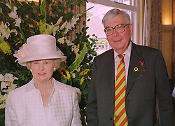 SIR JOHN & LADY SPARROW he is chairman of the Horserace Betting Levy Board, at a race meeting in Berkshire on 25th July 1998.MJF 17