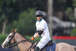 Prince Harry takes part in the Sentebale Royal Salute Polo Cup at the Singapore Polo Club.