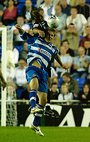 Photo: Daniel Hambury.<br /> Reading v Swansea. Carling Cup.<br /> 23/08/2005.<br /> Reading's Stephen Hunt and Swansea's Christian Edwards battle for the ball.