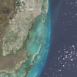 Many national parks in the United States can be experienced by driving scenic roads or hiking on trails. Visit Biscayne National Park in southern Florida, however, and you might want to explore by boat; 95 percent of this park is under water.<br /> On February 25, 2016, the Operational Land Imager (OLI) on the Landsat 8 satellite acquired this natural-color image of Biscayne National Park. The park encompasses the northernmost Florida Keys, starting from Miami to just north of Key Largo.<br /> The keys run like a spine through the center of the park, with Biscayne Bay to the west and the Atlantic Ocean to the east. The water-covered areas span more than 660 square kilometers (250 square miles) of the park, making it the largest marine park in the U.S. National Park System. Biscayne protects the longest stretch of mangrove forest on the U.S. East Coast, and one of the most extensive stretches of coral reef in the world.<br /> acquired February 25, 2016<br /> acquired July 10 -<br /> 14, 2001<br /> download large image (21 MB, JPEG, 10000x18000)<br /> acquired July 10 -<br /> 14, 2001<br /> download<br /> GeoTIFF file (21 MB, TIFF, 10000x18000)<br /> Some of what lies below those waters is visible in data acquired by the Experimental Advanced Airborne Research Lidar (EAARL). EAARL's Lidar measured the time it took for a pulse of light to go from the aircraft, through the water, reflect off the seafloor, and back to the airplane. Researchers can convert that travel time into measurements of height, and map the underwater topography. According to C. Wayne Wright, a remote-sensing scientist who worked at NASA's Wallops Flight Facility, EAARL was designed and built by NASA specifically to get a high-resolution look at coral reef environments.<br /> The highlighted area in the second image above shows where EAARL acquired data in Biscayne National Park from July 10–14, 2001. The third image shows a detailed view of the center of the study area. White and light blue are the